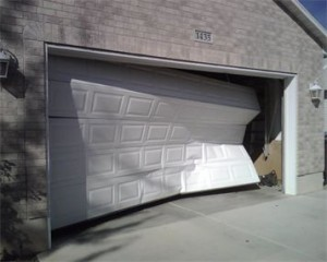 broken or dented garage door panel contact us today for help