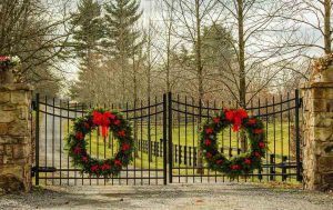 Driveway gate with holiday wreaths