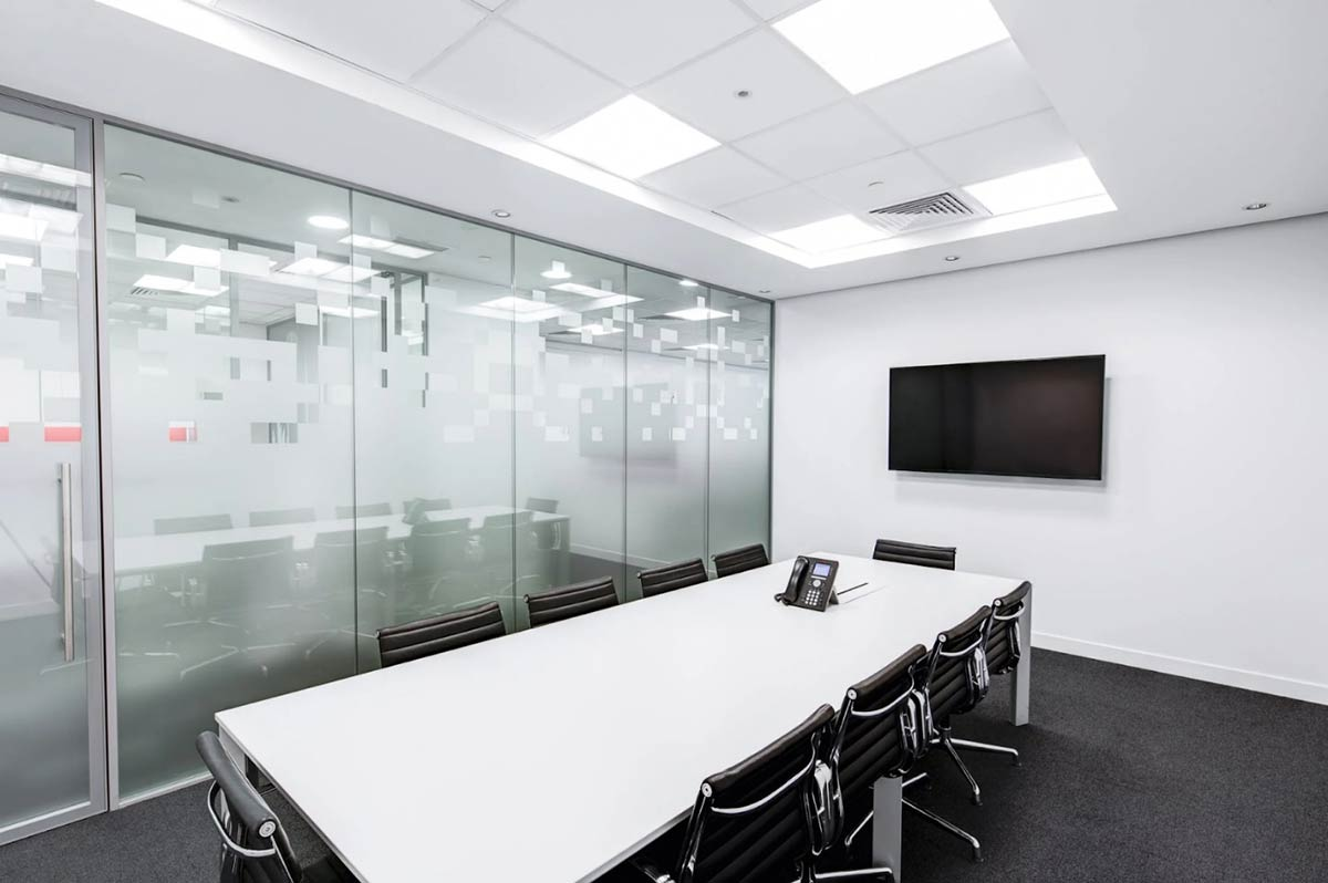 Glass operable wall being used in an office environment. It looks like a regular glass wall with no tracks or wheels.