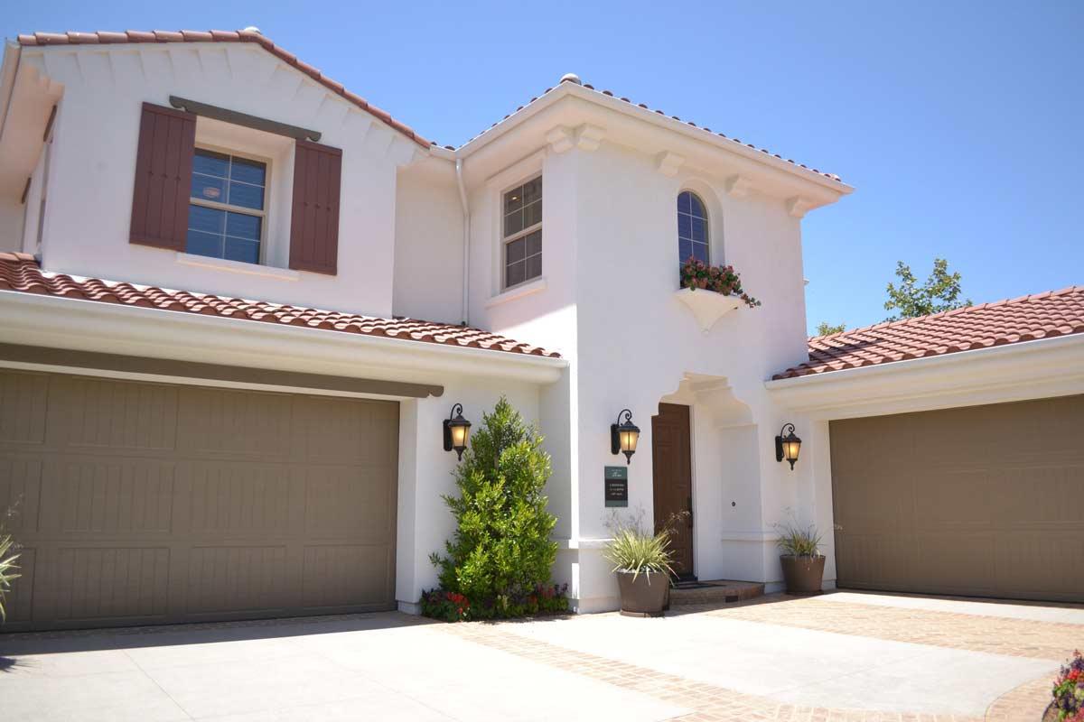 House that has a brown garage door with a standard bottom garage door seal type.
