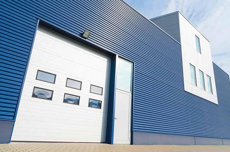 Picture of exterior warehouse showcasing The Door Company's garage door services
