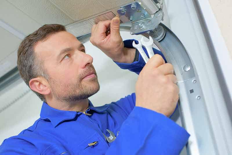 Repairman providing residential garage door services